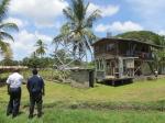 Kei and Major Vari look over the Kwikila property plans.
